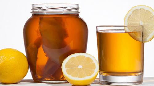 Kombucha super food pro biotic beverage in glass with lemon on w